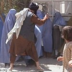 Taliban beat a woman in KabulSep.2001
